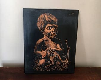 Vintage copper artwork of boy