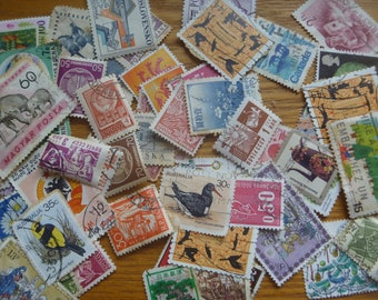 60 used postage stamps, various themes