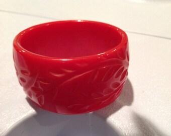 Beautifully carved vintage red Bakelite bangle bracelet