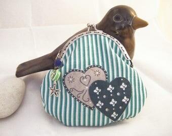 Retro purse in green and white striped fabric