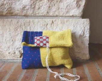 Blue polka dot fabric bag, rug / fake fur yellow mustard and lace