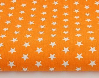 100% cotton fabric printed 50 x 160 cm pattern white stars on orange background