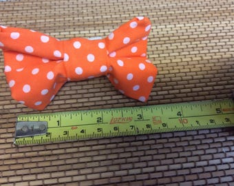 Handmade bright orange and white dot dog bow