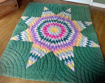 Handmade quilt ,  100 percent cotton, hand quilted quilted , Hand sewn together, 73x58, feed sack