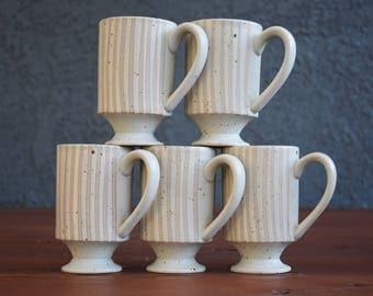 Stoneware mugs; set of five mugs