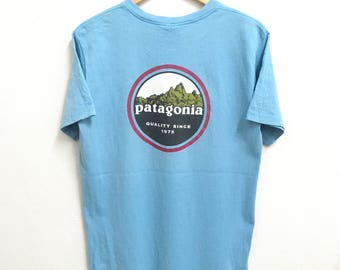 RARE!!! Patagonia Big Logo Multicolor SpellOut Crew Neck Light Blue Color T-Shirts S Size