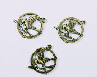 3 pcs 25mm antiqued bronze plated hunger games mockingjay bird and arrow charms