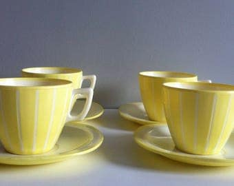 Welware lemon yellow cups and saucers set of 4, mid century melamine.
