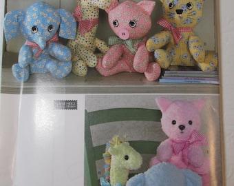 Simplicity Pattern 2613 Two-pattern piece stuffed animals: elephant, giraffe, pig, cat