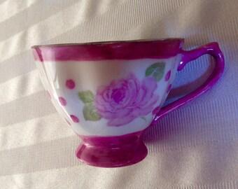 Pink teacup and saucer