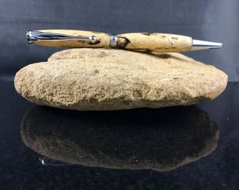 Handcrafted spalted tamarind wood pen with chrome hardware. Beige body with pops of black throughout. Great gift for you or someone special!