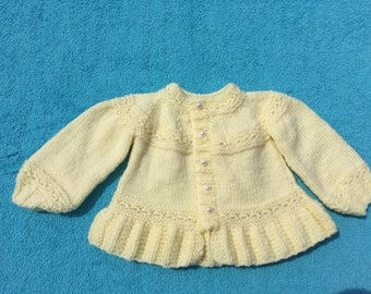 beautiful hand knitted prem baby jacket