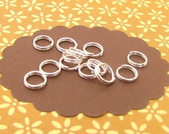 Double 6mm silver AA41 50 rings