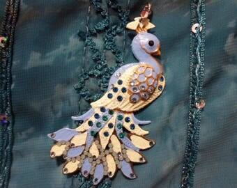 Pendant of a Peacock or phoenix blue/green and glittering feathers.
