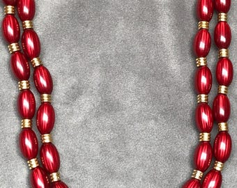 Double strand beaded cranberry and gold necklace