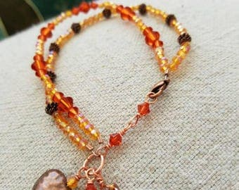 Layered bracelet with swarovski   crystals and a copper charm