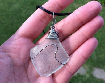 Clear sea glass wave pendant.