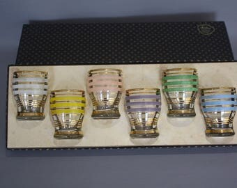 Set of 6 vintage Astra shot glasses