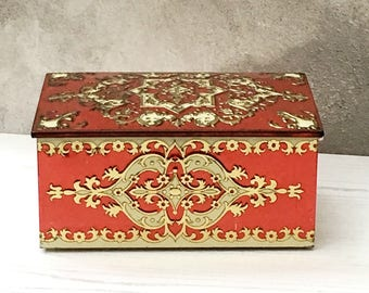 A Beautifully Embossed, Red Gold and Cream Tin