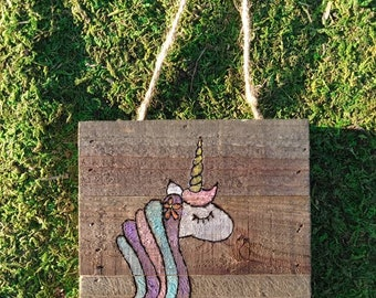 Cute unicorn done in pyography on wooden box thing.