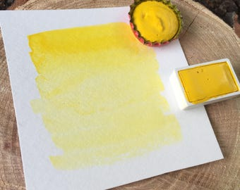 Full pan or bottle cap of handmade Sun yellow watercolor paint