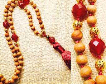 108 bead meditation mala, fragrant sandalwood, carnelian, gold plated copper, nylon string, silk tassel