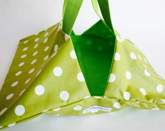 Tart lime green oilcloth bag with white dots