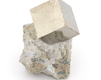 Pyrite crystal cube on matrix of 82 grams from Navajun, Spain.