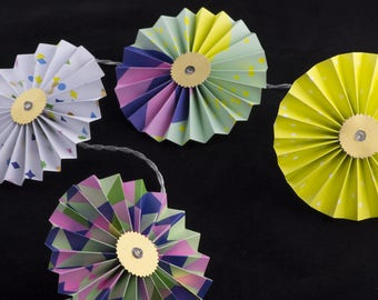 Garland bright multicolored paper rosettes