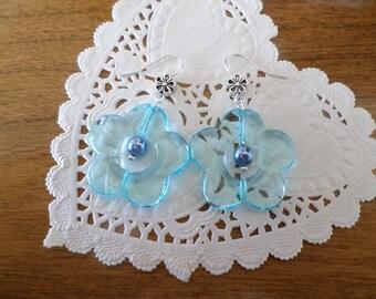 Translucent blue flower earrings.