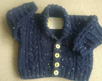 Hand knitted Aran baby jacket