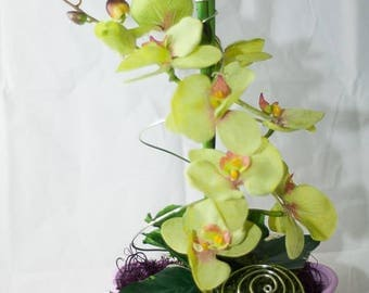 Flower arrangement in violet and green with phalenopsis