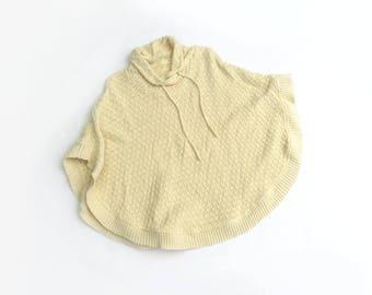white woven poncho / sweater