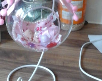 Little princess in a glass bauble with stand