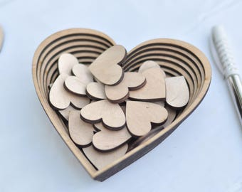 Wooden hearts for a wedding guest book