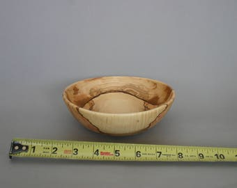 Small hand turned olive wood bowl.