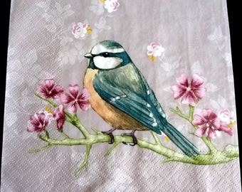 Paper towel the bird on a branch decorated with flowers