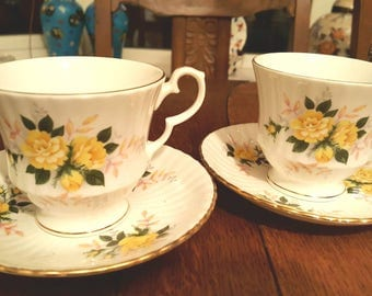 Yellow roses tea cups and saucers