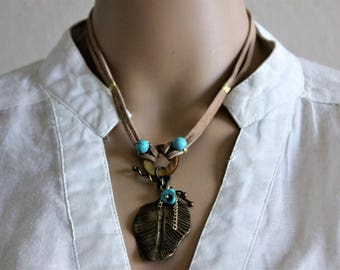 Metal Leaf with Turquoise beads on a Tan Suede Cord Necklace