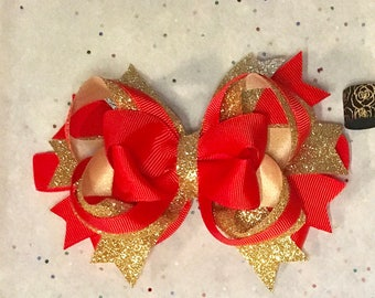 4 inch red and gold hairbow.