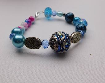 Ornate blue and gold bracelet