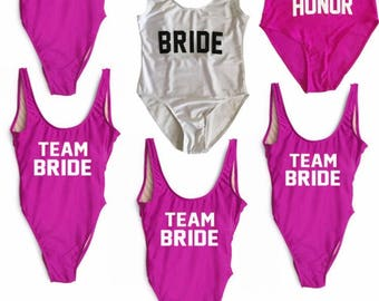 Bride, 4 team bride suits, and 1 maid of hinor suit. set of 6, swim suit, one piece