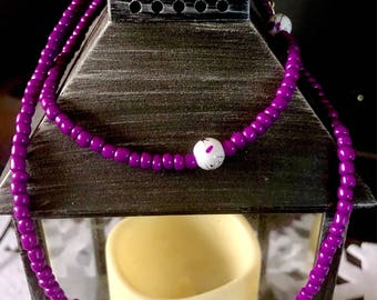 Purple beaded necklace with marbled feature beads