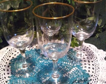 A set of 4 Crystal Noritake Water Goblets with gold rim