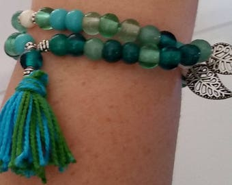 Blue Beaded Bracelet with Feathers