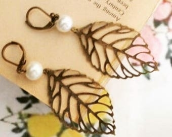leaf and pearl earrings.