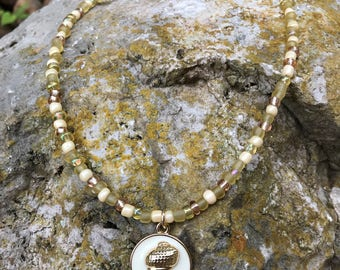 White and Gold Seashell Pendent on a Cream, Yellow, and Gold Seedbead Necklace