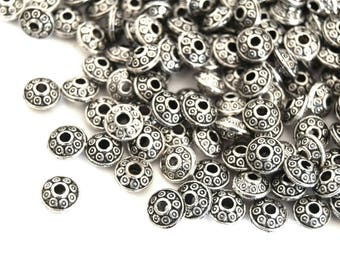 set of 20 beads 6.5 x 4 mm Tibetan silver