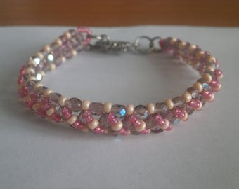 "Bracelet ""pink, orange, purple"" tones."