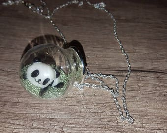 Clear green microbeads and panda globe necklace